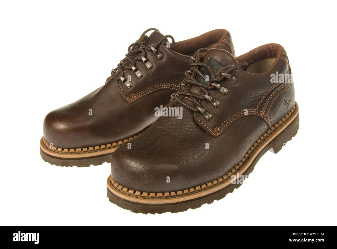 A pair of new steel toed shoes which are required in most heave industries where injuries could occur Stock Photo