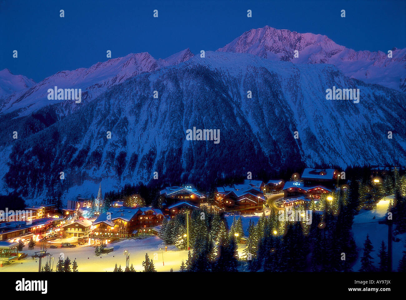 VIEW OF FLOODLIT COURCHEVEL 1850 AT NIGHT, 3 VALLEYS, TROIS VALLEES, FRANCE - Stock Image