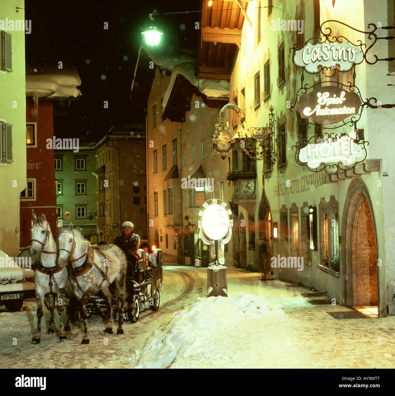 HORSE DRAWN SLEIGH IN  STREET KITZBUHEL TYROL AUSTRIA Stock Photo