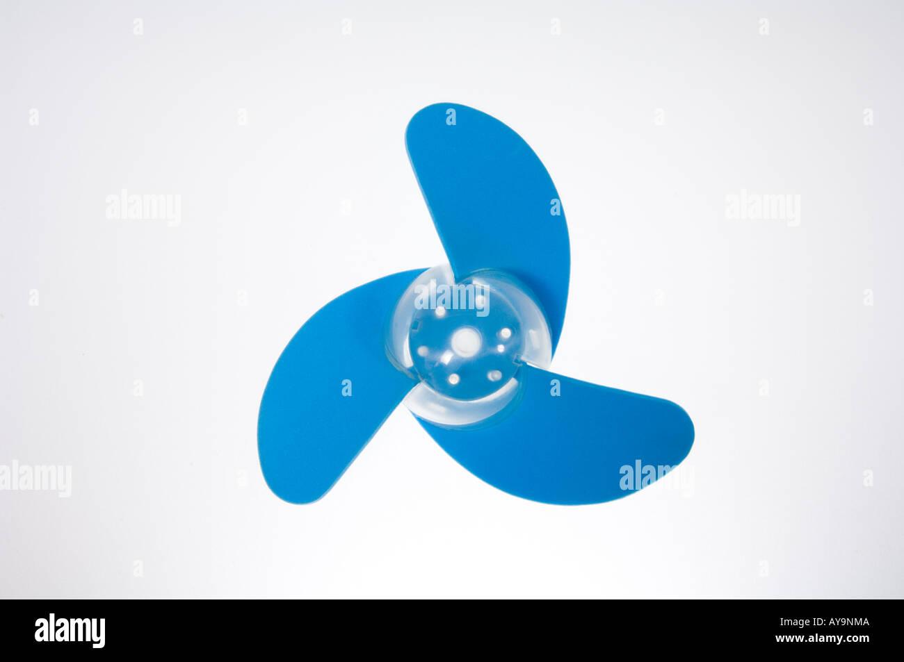 A blue propeller from a small desktop fan - Stock Image