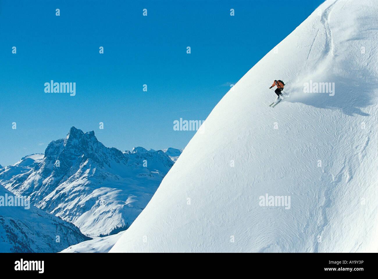 Off piste skier on steep incline, St Anton Am Arlberg, Tyrol, Austria - Stock Image