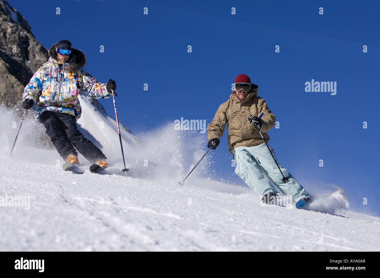 Two skiers dangerously close on slopes in Tignes, France - Stock Image