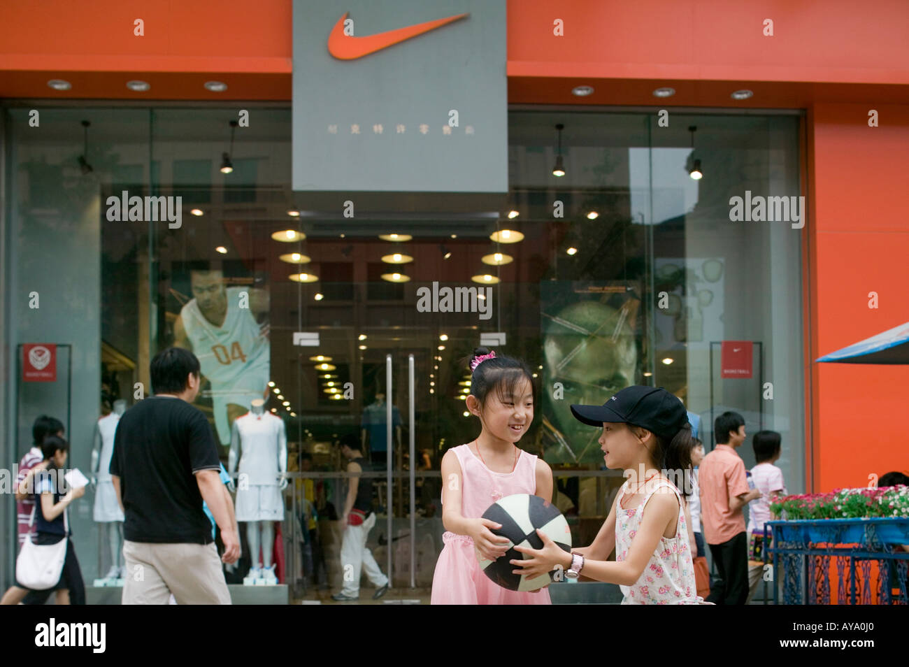 the best attitude a044e 87f28 Asia China Beijing Young girls play basketball in front of Nike Store along  pedestrian shopping street in Dong An Plaza