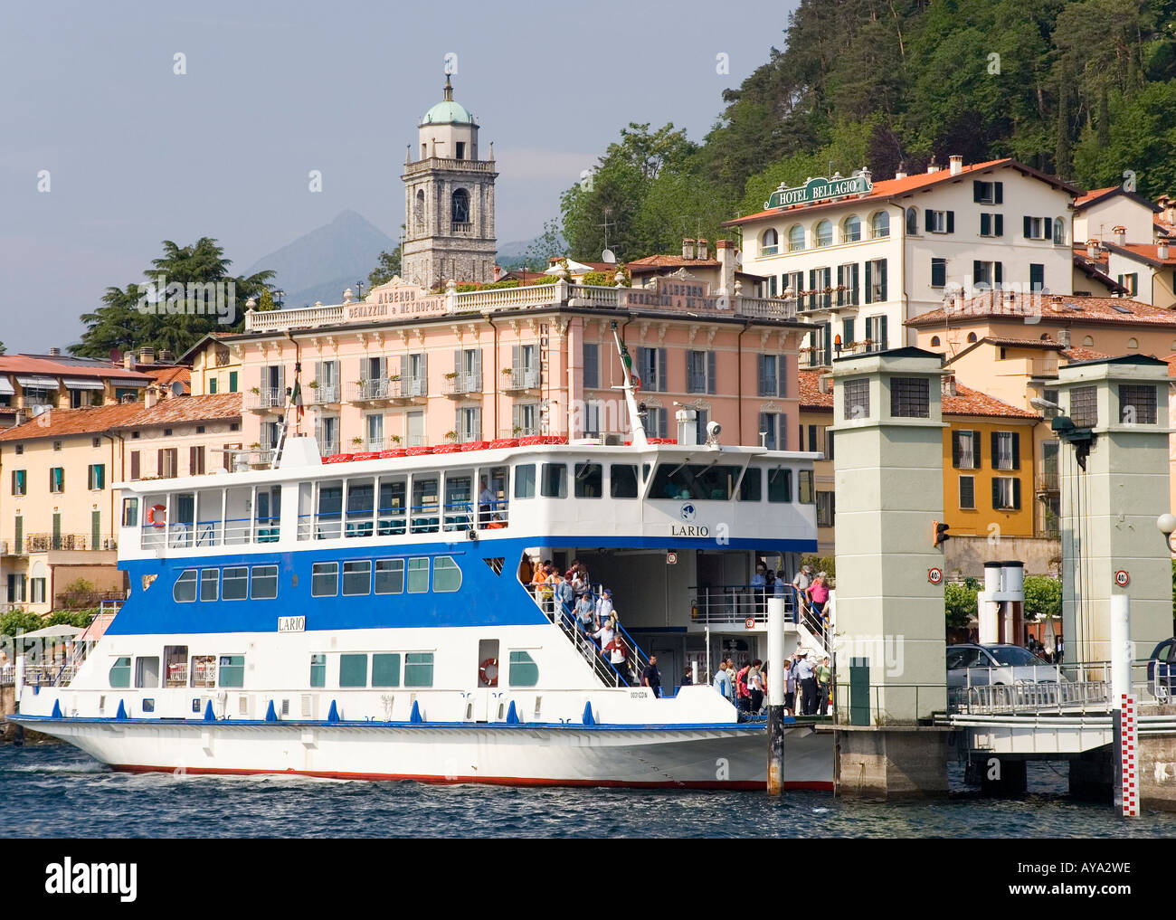 A ferry boat arrives in Bellagio, Lake Como, Italy - Stock Image