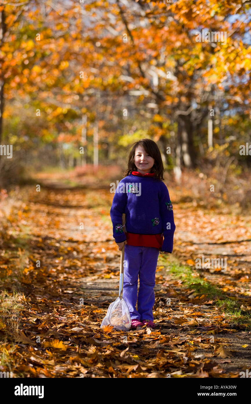 A young girl (age 6) on a woodland trail in Biddeford, Maine - Stock Image