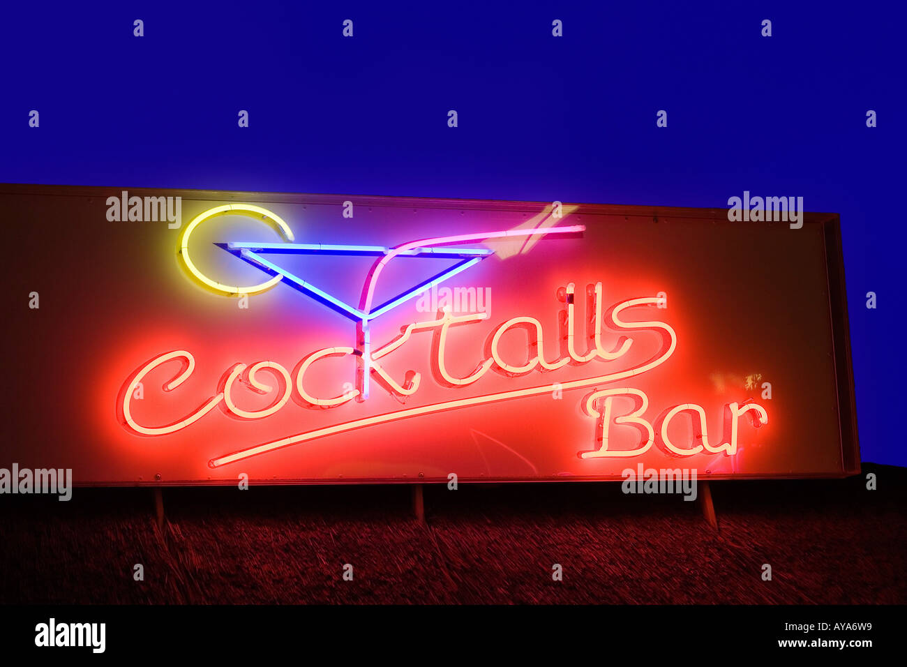 Luminous advertising for a cocktails bar - Stock Image