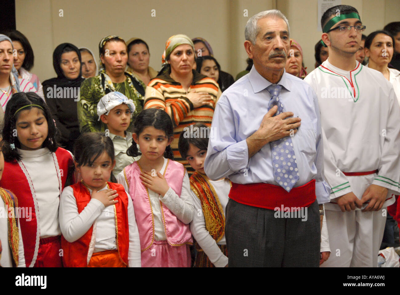 YOUNG AND OLD ETHNIC ALEVIS DURING THE 'SEMAH CEREMONY'IN NORTH LONDON ALEVI CULTURAL CENTER - Stock Image