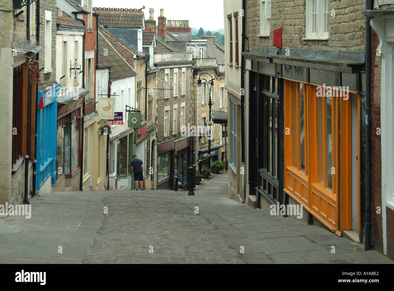 Frome one of a number of quaint narrow hilly side streets which house a selection of small shops and eating venues Stock Photo
