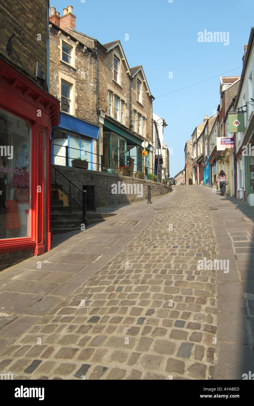 Frome a quaint narrow hilly side streets housing a selection of small shops and eating venues with dwellings above Stock Photo