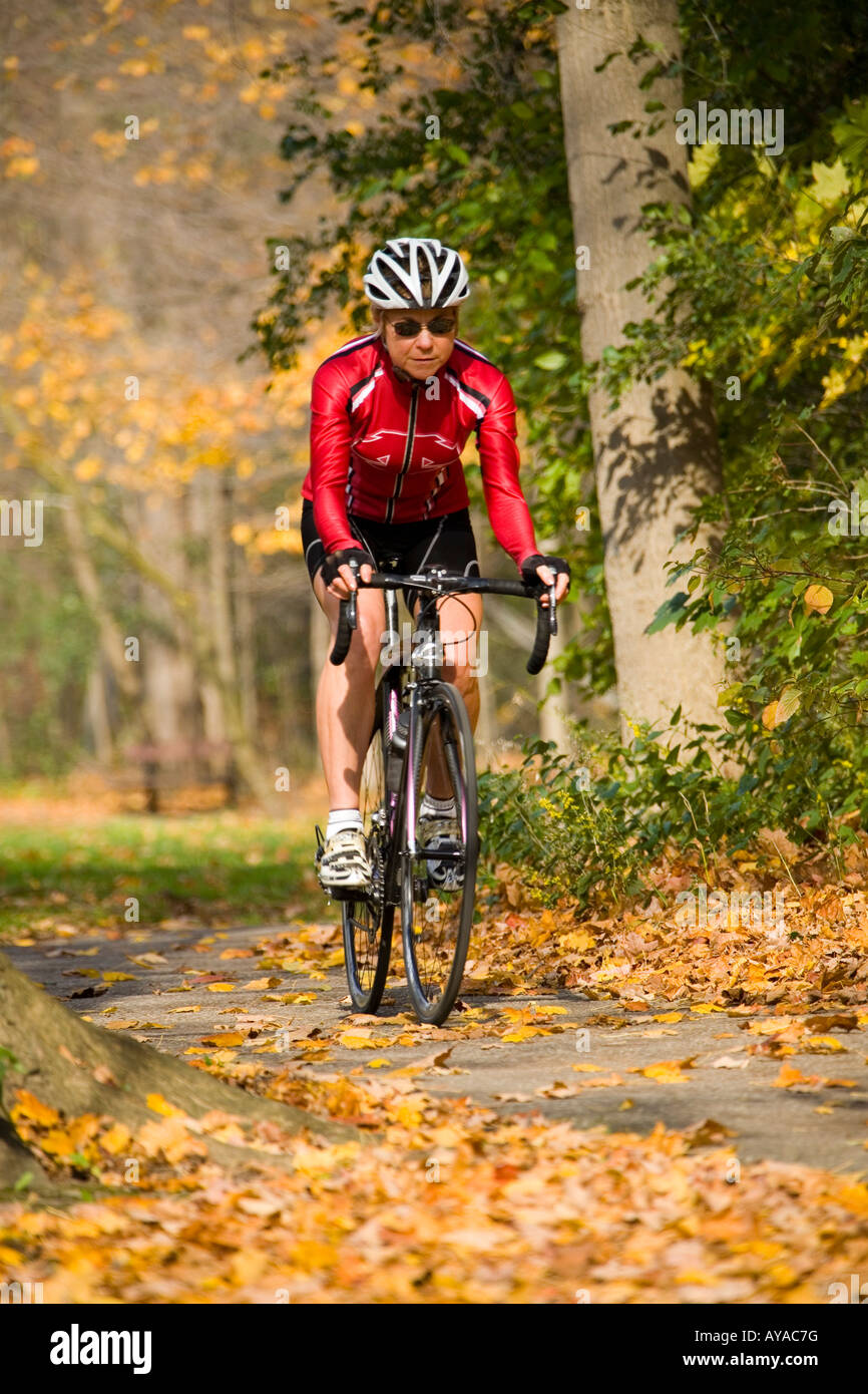 Cyclist on recreational trail in the autumn - Stock Image