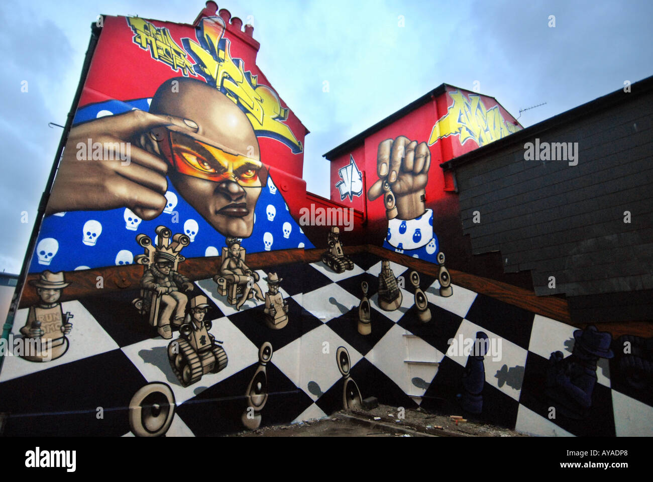 Graffiti art on the gable ends of terraced houses in Brighton - Stock Image