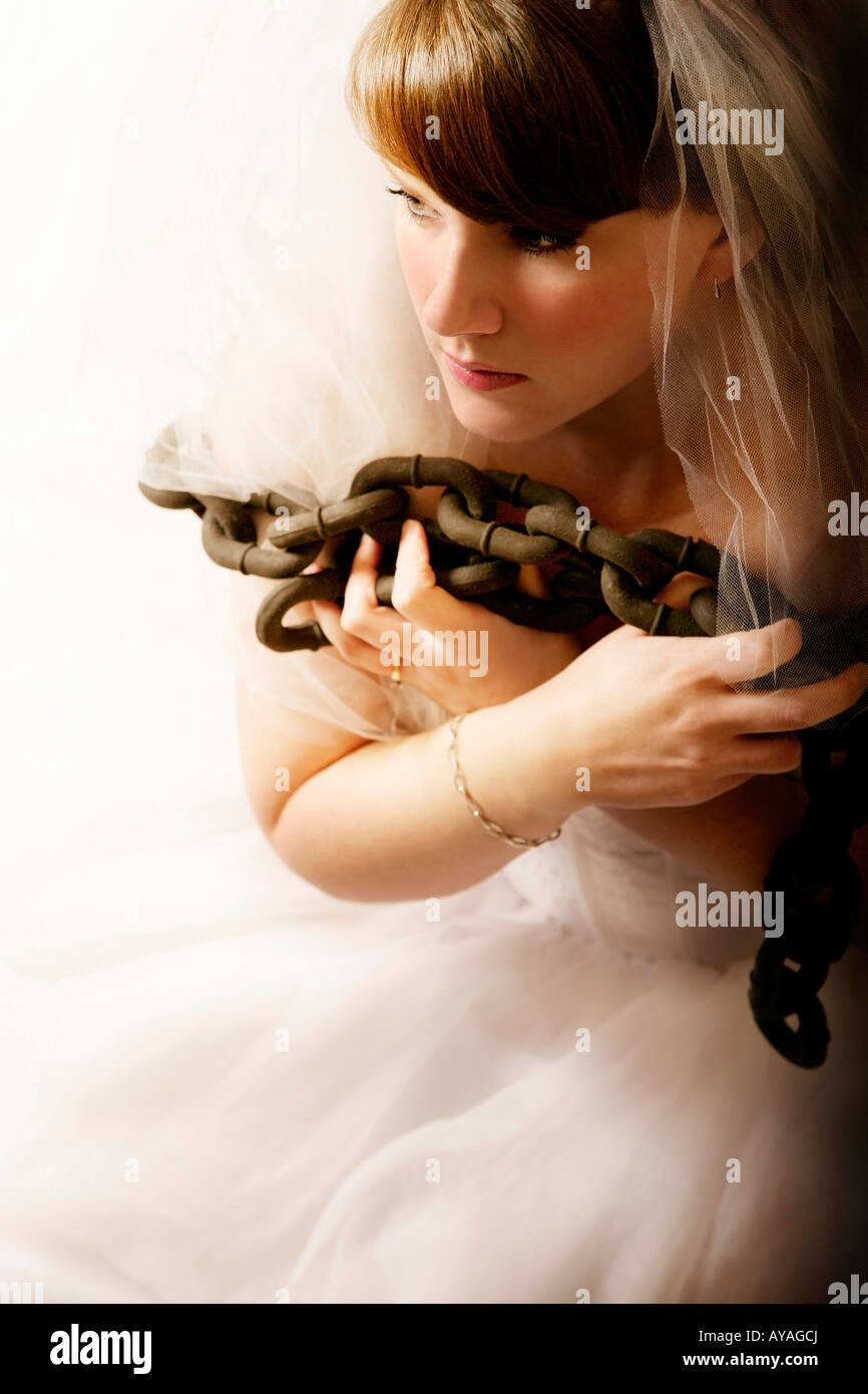 Bride in bondage - Stock Image