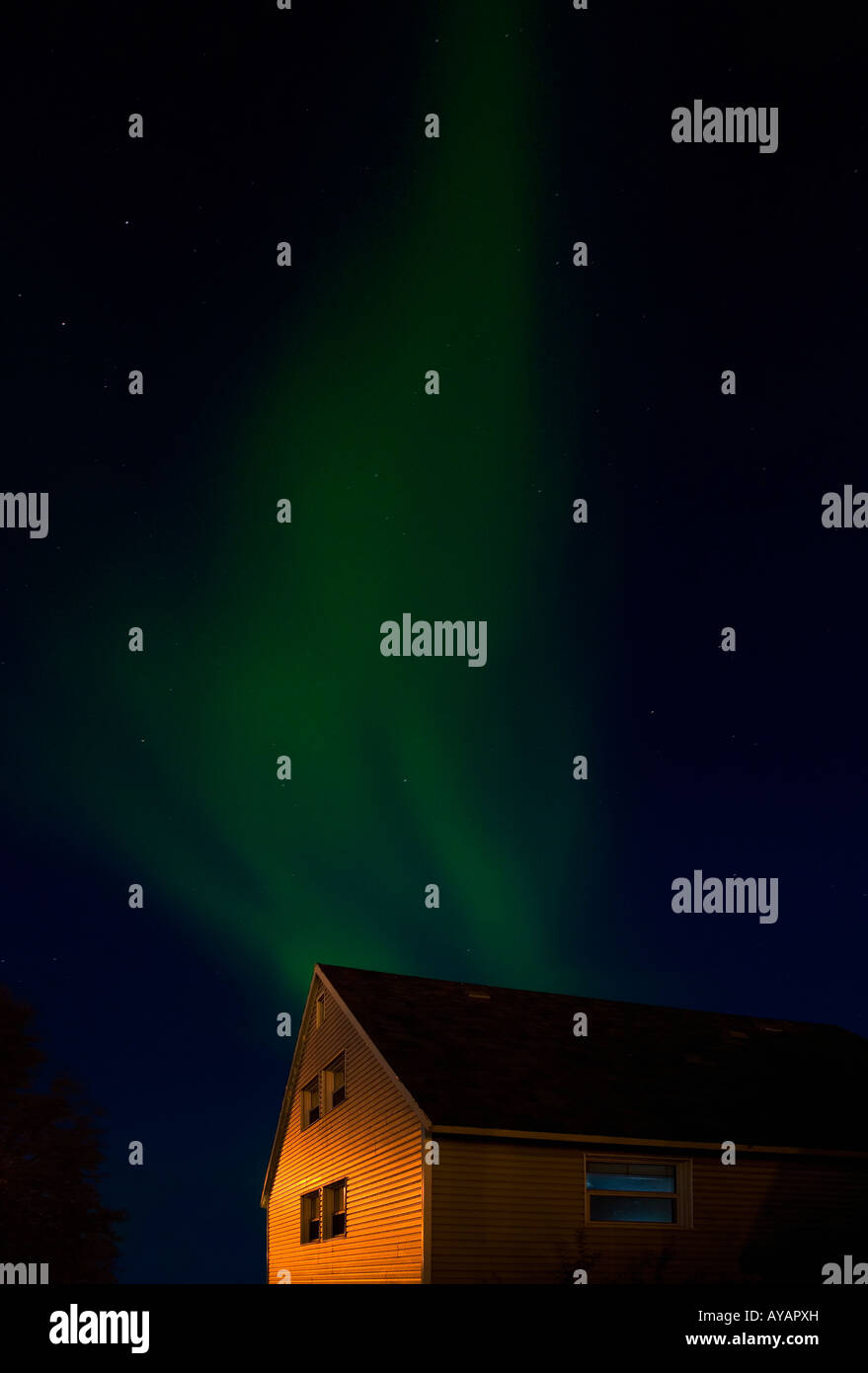 Northern lights and a house, Inuvik, Northwest Territories, Canada - Stock Image