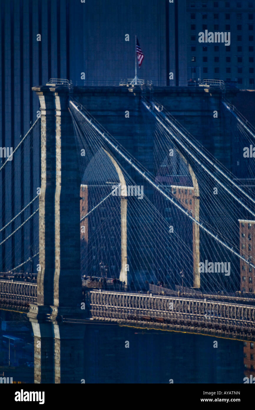 Afternoon sun shines on the west tower of the Brooklyn Bridge New York City - Stock Image