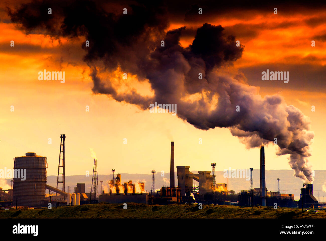 Smoking chimney showing pollution Stock Photo
