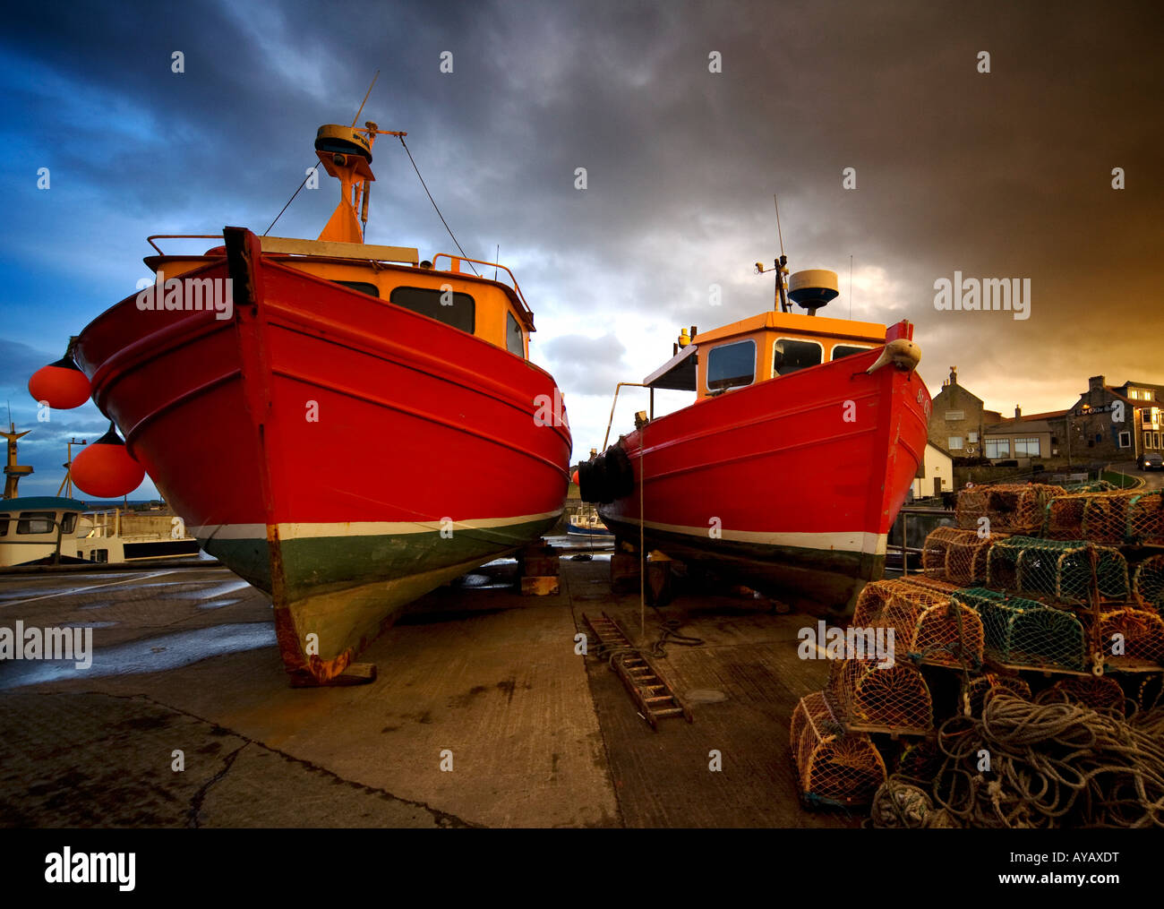 Fishing boats out of the water for winter, Northumberland, England - Stock Image