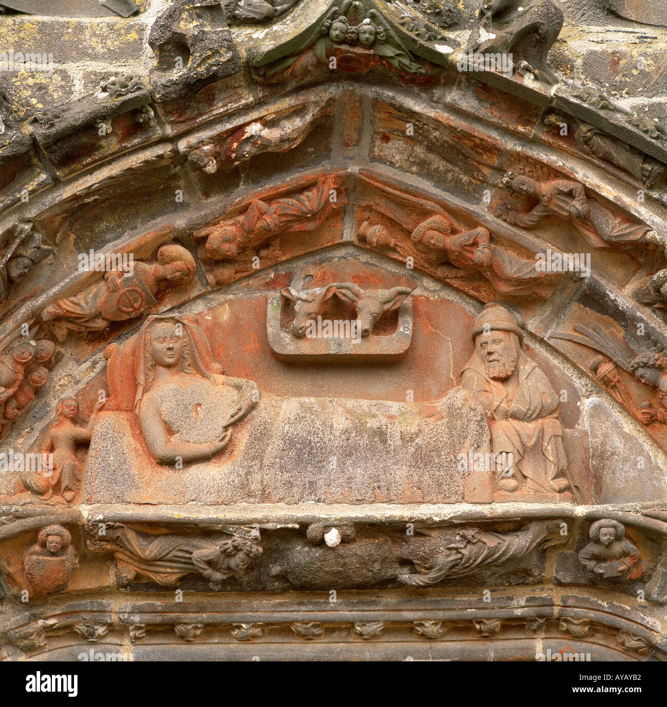Sculptural relief above a doorway, La Martyre, Brittany. Depicts Mary and Joseph in the stable surrounded by angels. - Stock Image