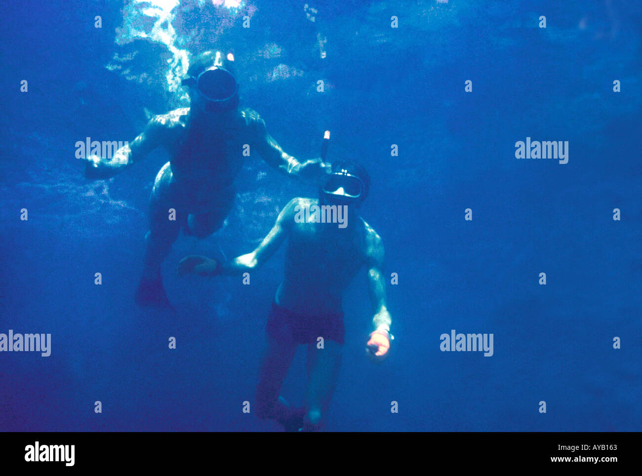 couple snorkelling underwater - Stock Image