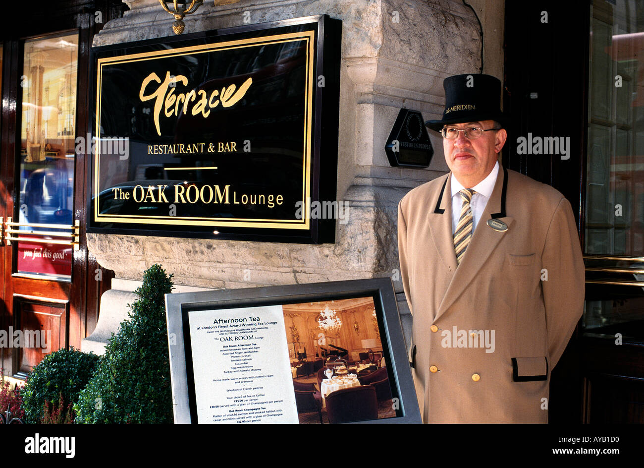 Le Meridien Hotel Oak Room Picadilly London with the Hotel Doorman - Stock Image