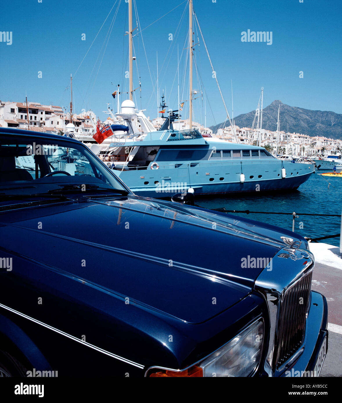 Bentley and Private Yacht at Puerto Banus Spain - Stock Image
