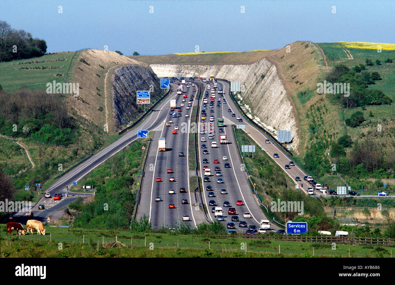 M3 Motorway traffic cuts through the countryside at Twyford Down near Winchester in Hampshire UK - Stock Image