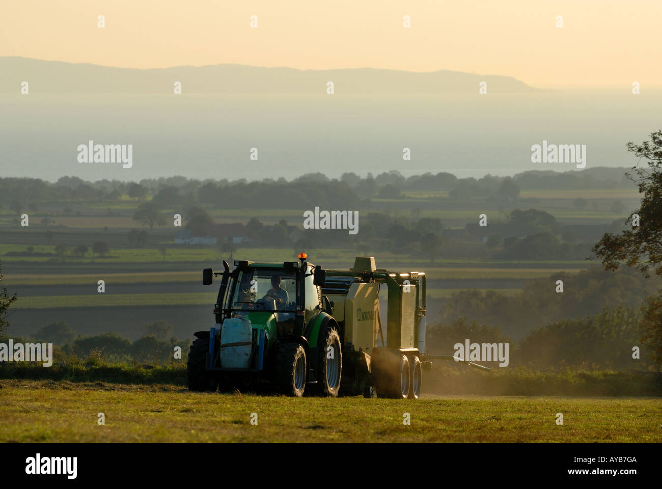 Tractor working in fields Bjare Skane Sweden farming - Stock Image