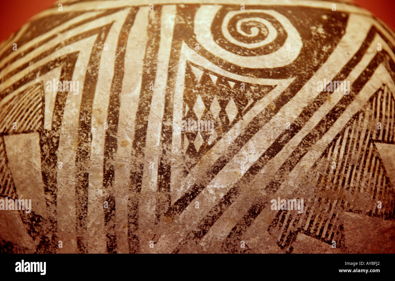 Anasazi Native-American Indian art, in the form of a geometrically  painted clay pot, at Gran Quivira Ruins, New Mexico. - Stock Image