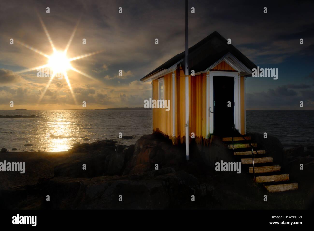 Little yellow coastal hut Torekov Skane Sweden - Stock Image