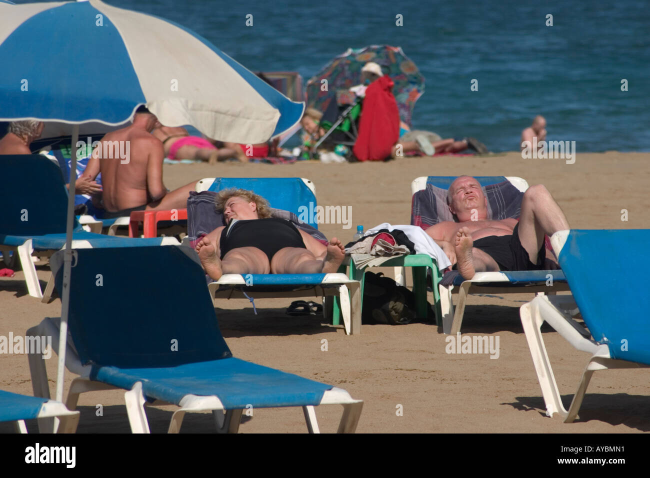 Mature Couple Sunbathing On Beach Stock Photos Amp Mature