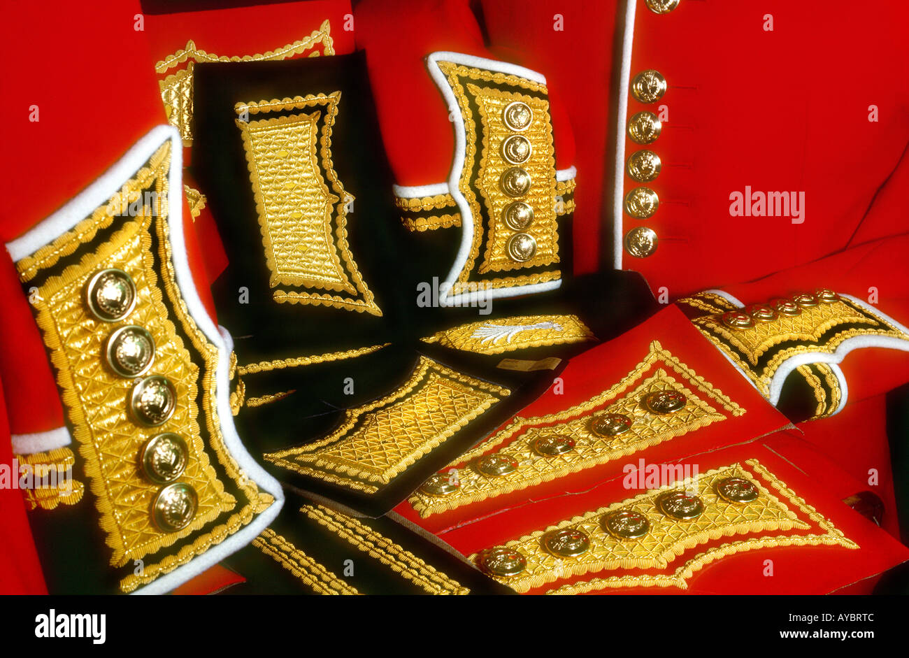 Still life, Swatches of red scarlet cloth with gold braid
