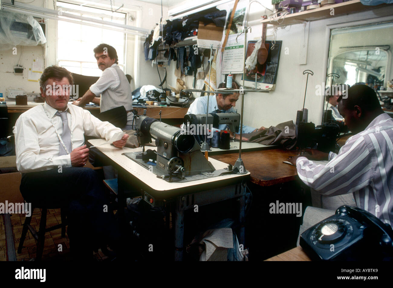 Brian Staples and staff Savile Row tailors seen here in their upstairs workroom previously sweat shops in Carnaby Street London - Stock Image