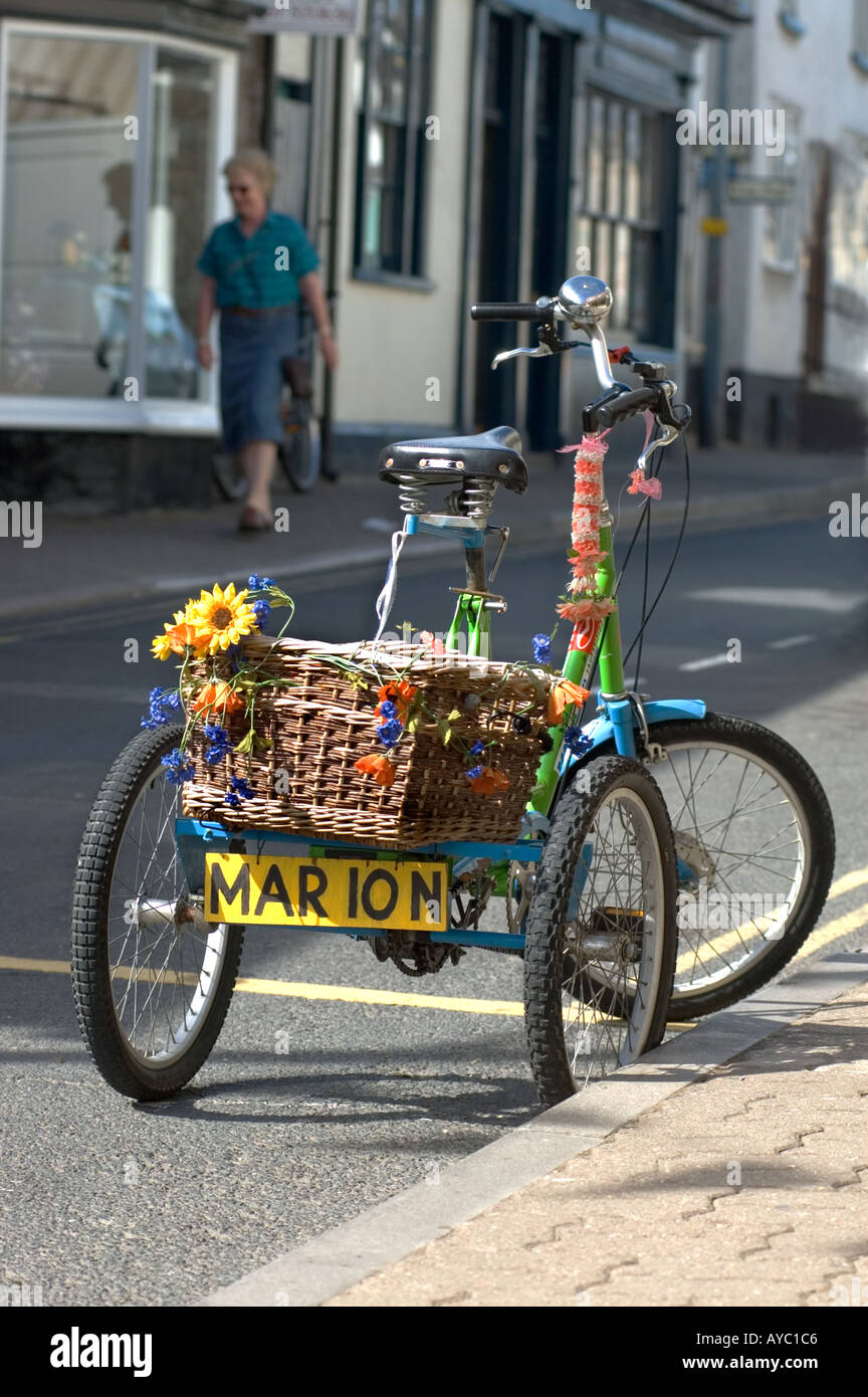 A tricycle parked in the street at Hay-on-Wye, Powys, Wales, UK. - Stock Image