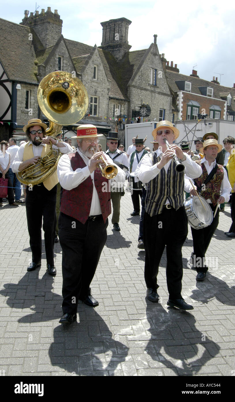 Brass band marching through West Malling in Kent - Stock Image
