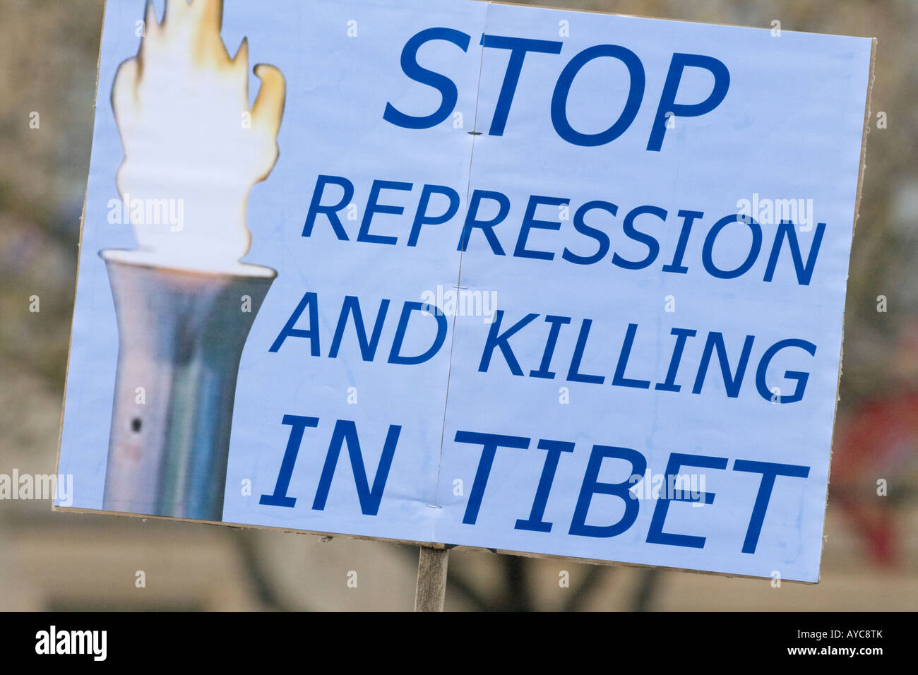 A sign reads Stop Repression and killing in Tibet - Stock Image