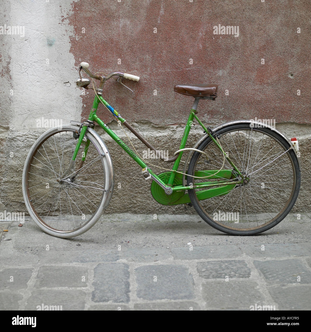Bicycle leaning against wall in Italian town Stock Photo