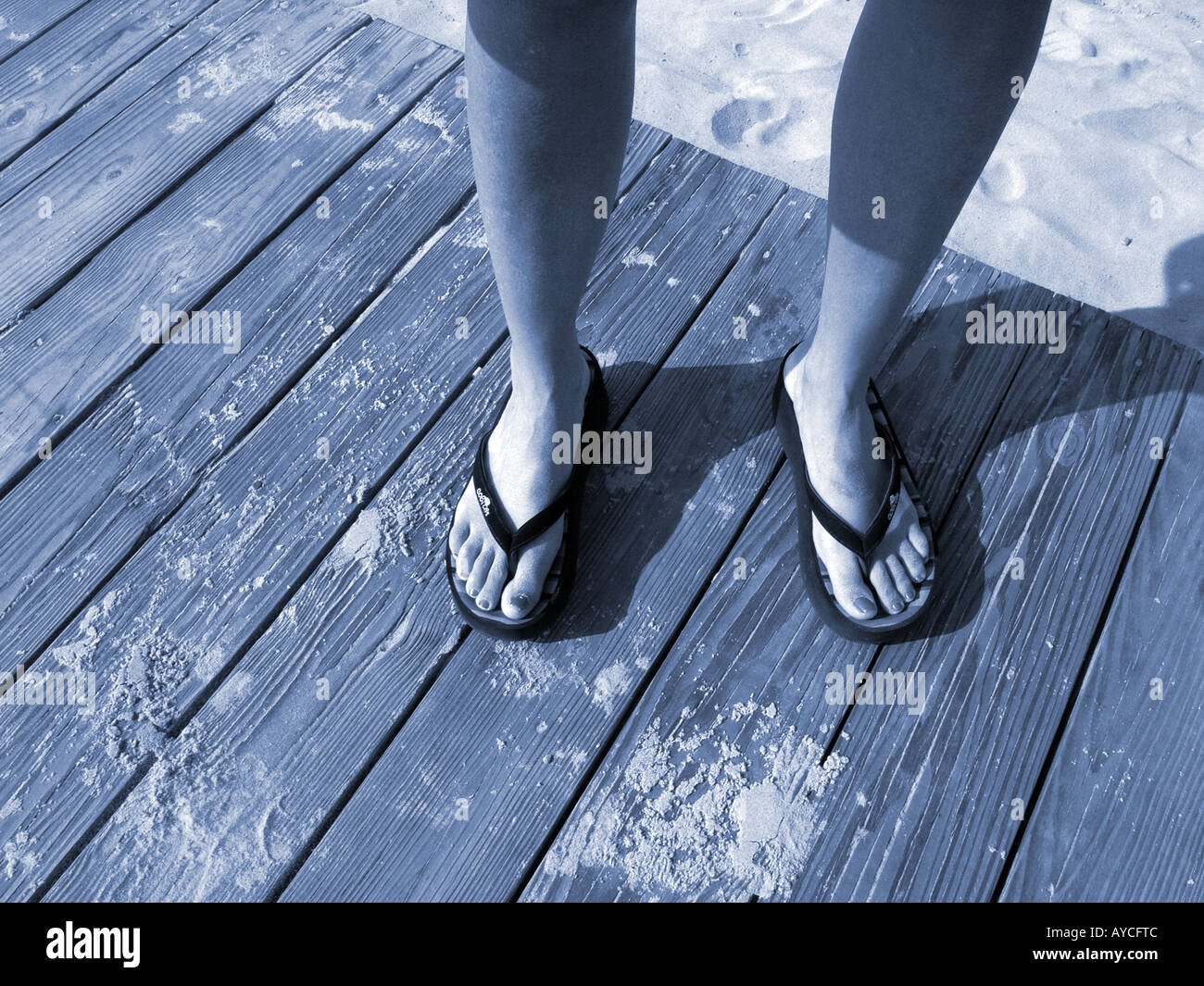 c35855bafcc363 Woman s Feet in Flip Flop Sandals on Boardwalk at Beach Stock Photo ...