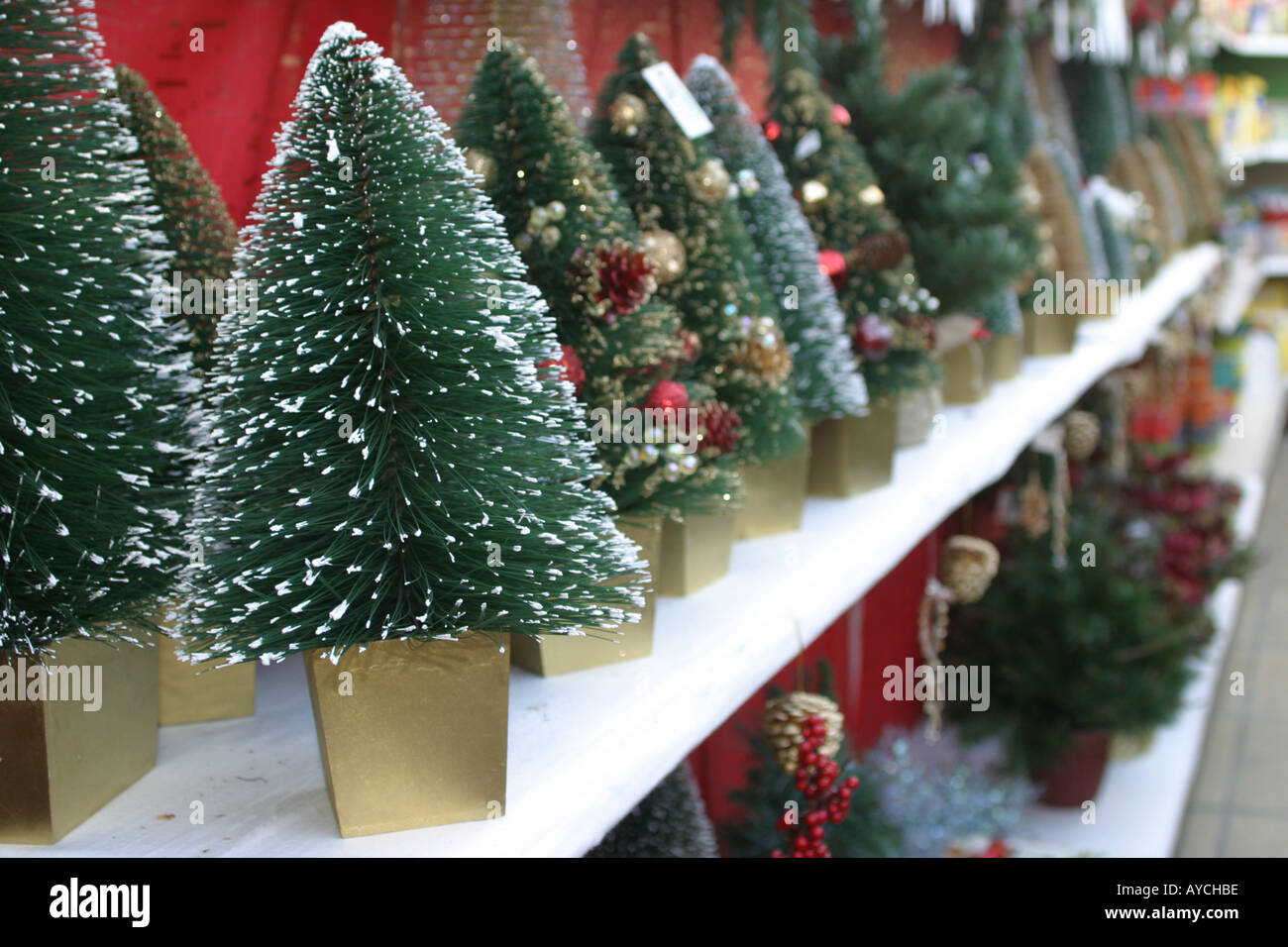 Small artificial Christmas trees on sale at a garden centre in the ...