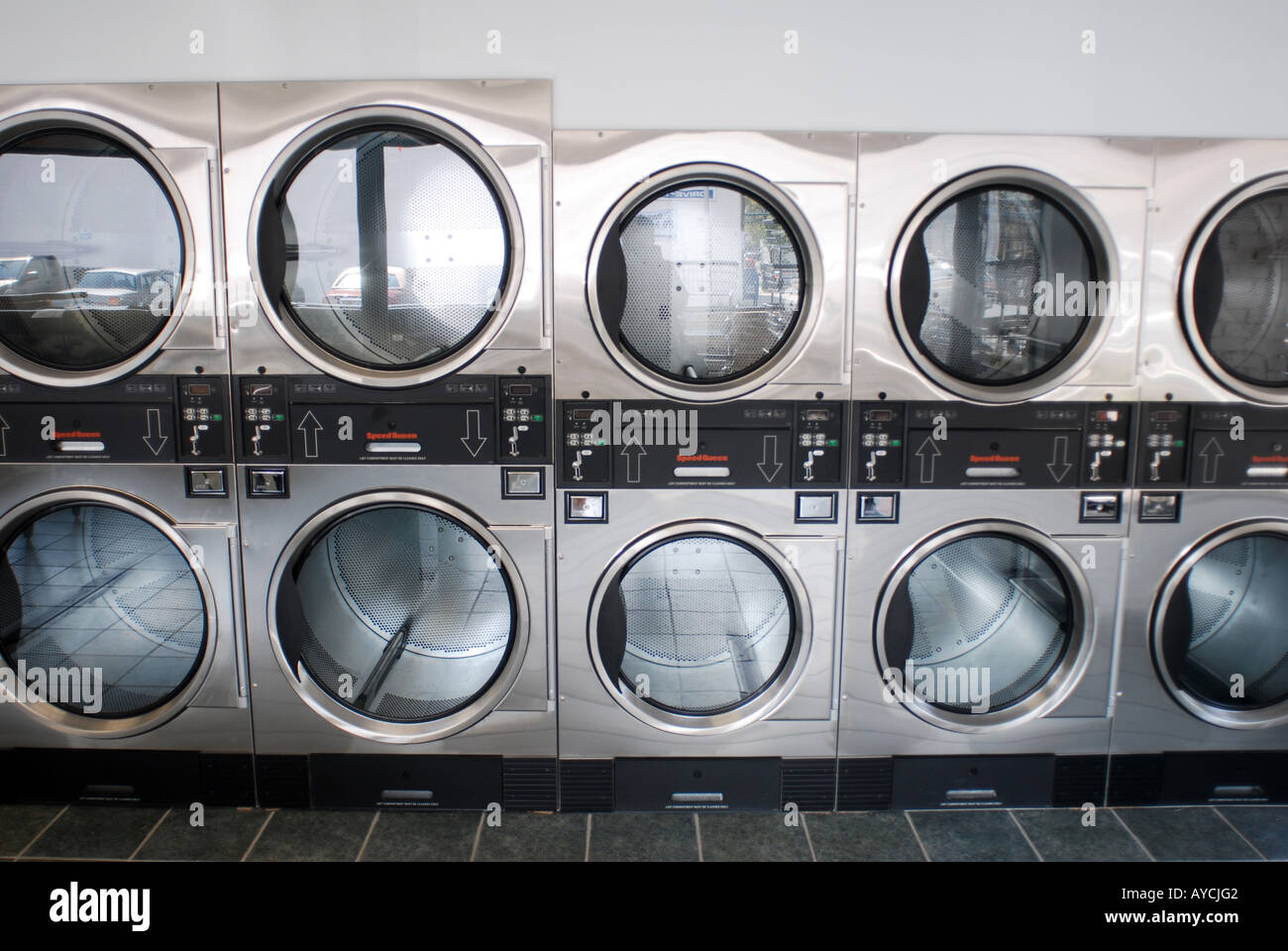 Rows of Coin Operated Laundromat dryers - Stock Image