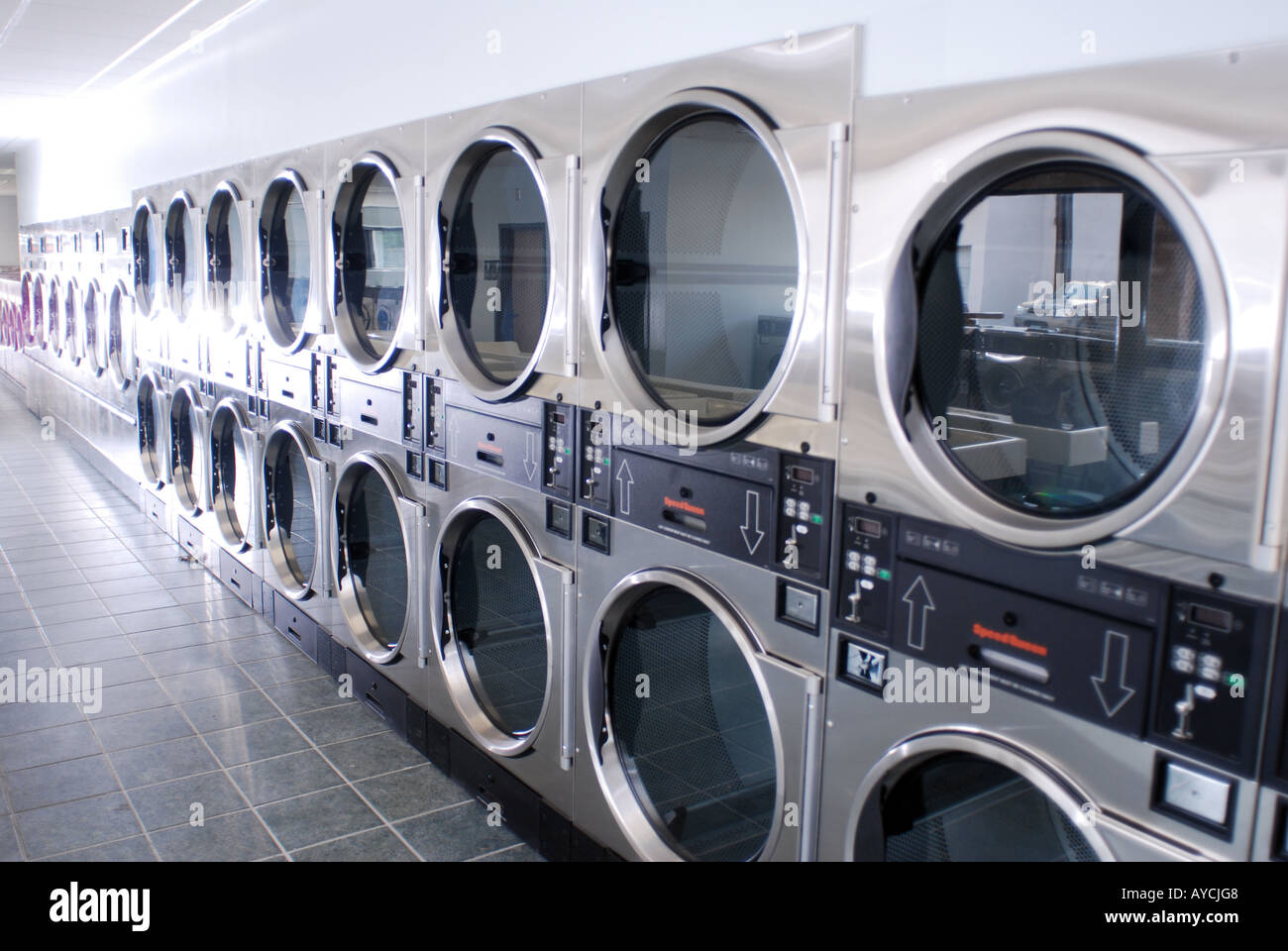 Rows of Brand New Coin Operated Laundry Dryers in new