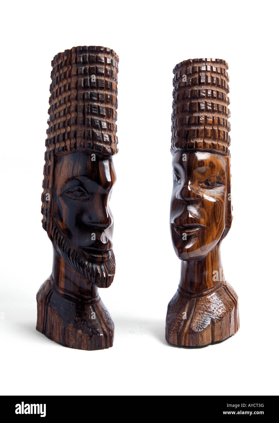 Pair of Ghanaian wooden head busts on white background - Stock Image
