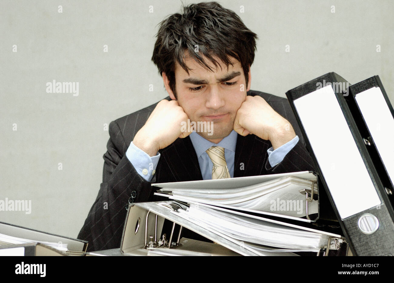 Businessman with messy desk - Stock Image