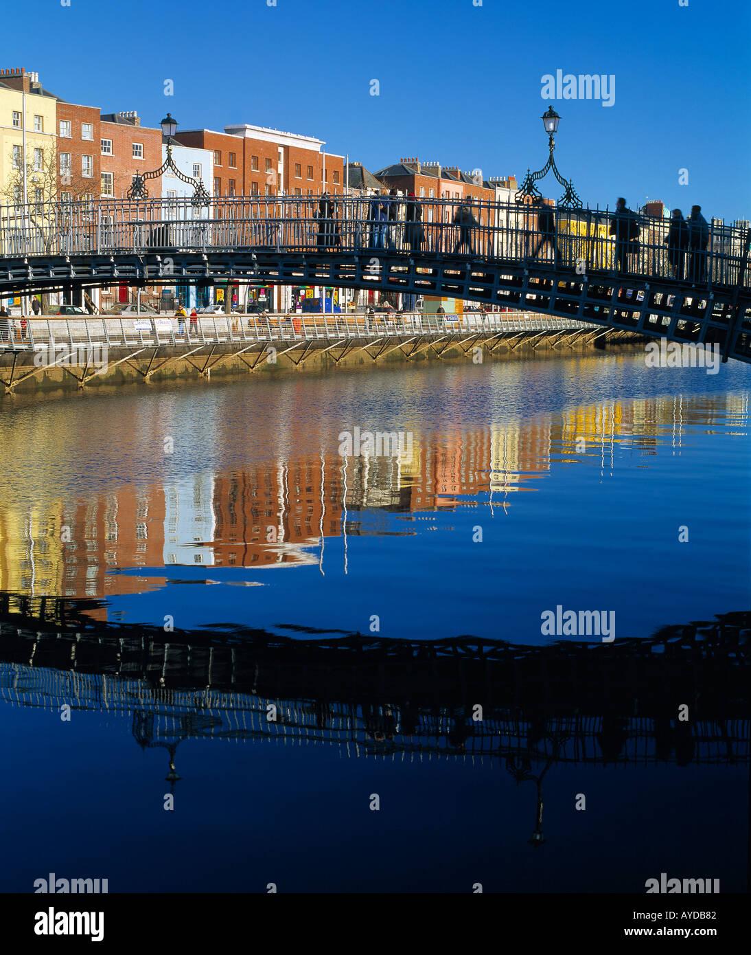 1/2 half penny bridge river liffey, dublin ireland, old narrow pedestrian walk  historic bridge over irelands river liffey - Stock Image