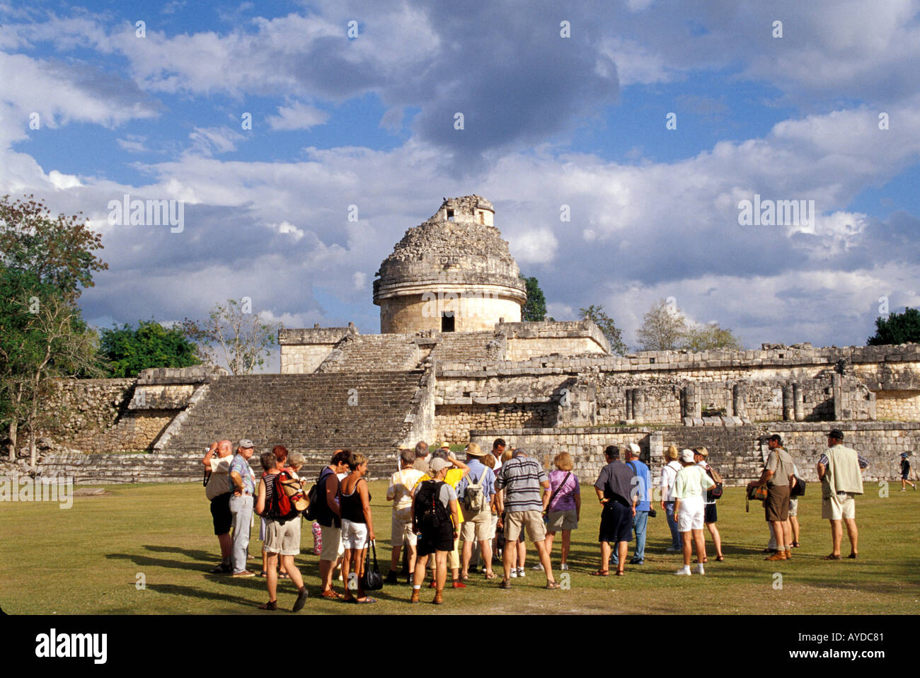 Chichen Itza The Observatory group of tourists on tour cruise excursion tourist tours Mayan archaeological site Mexico - Stock Image