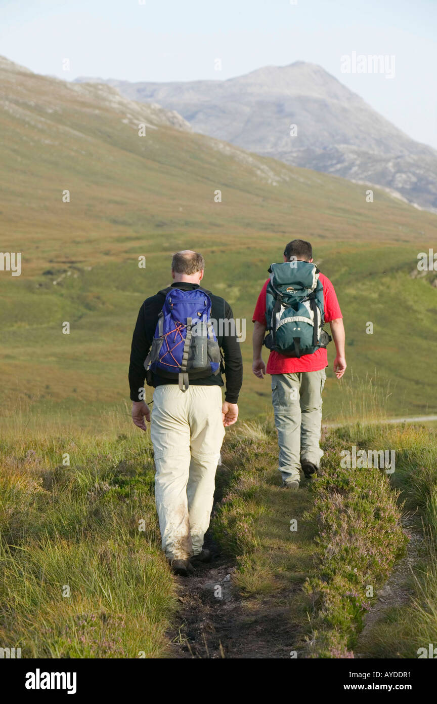 Hill walkers walking out from Quinag, sutherland, Scotland, UK - Stock Image