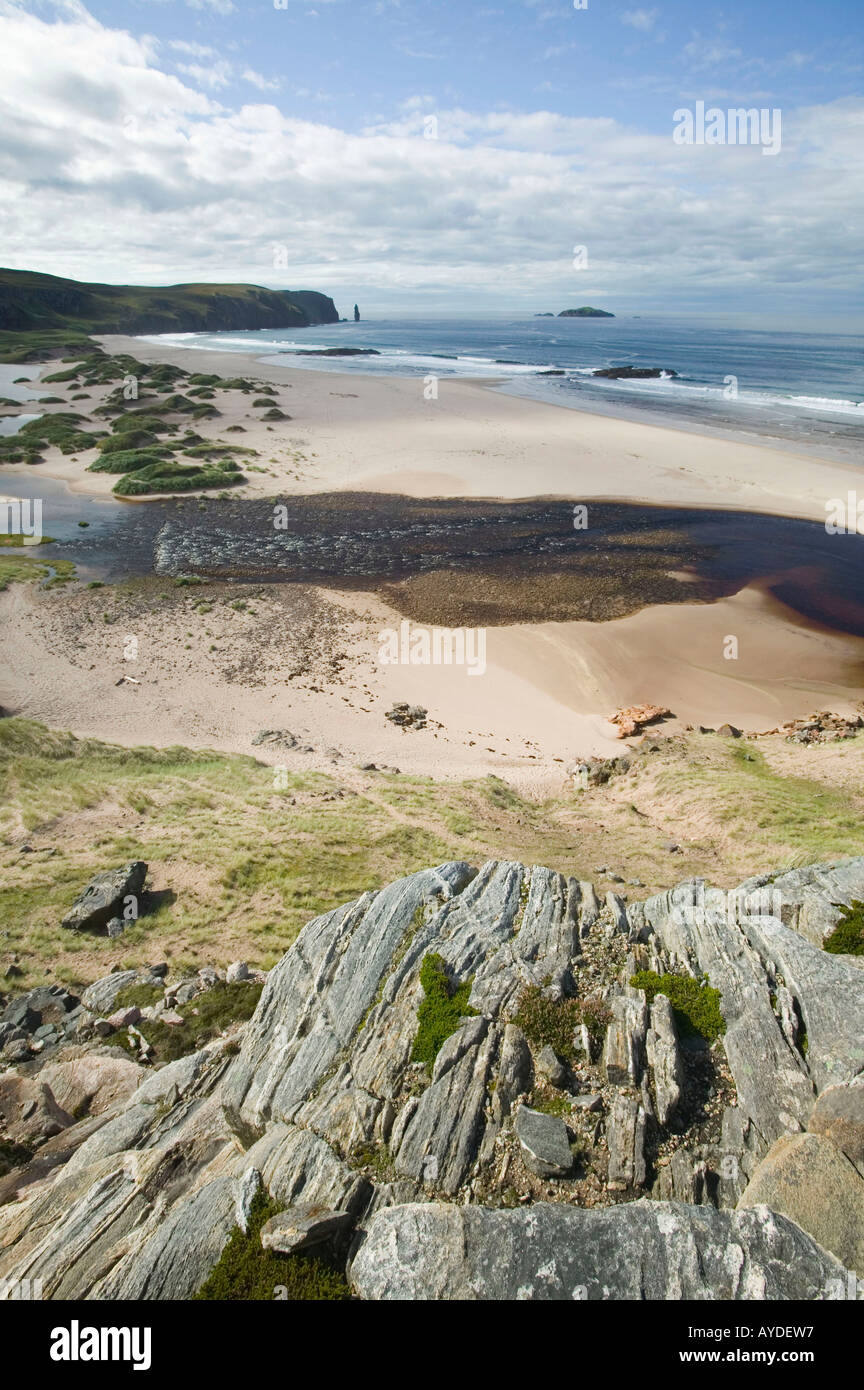 Sandwood Beach, Sutherland, Scotland, UK, and peat staining in the outflow of Sandwood river - Stock Image