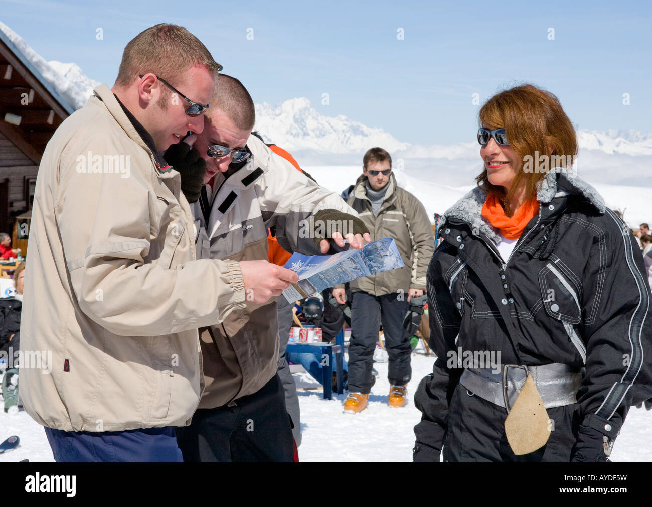 Skiers On The Piste Choosing Directions In La Plagne The French Alps France Europe - Stock Image