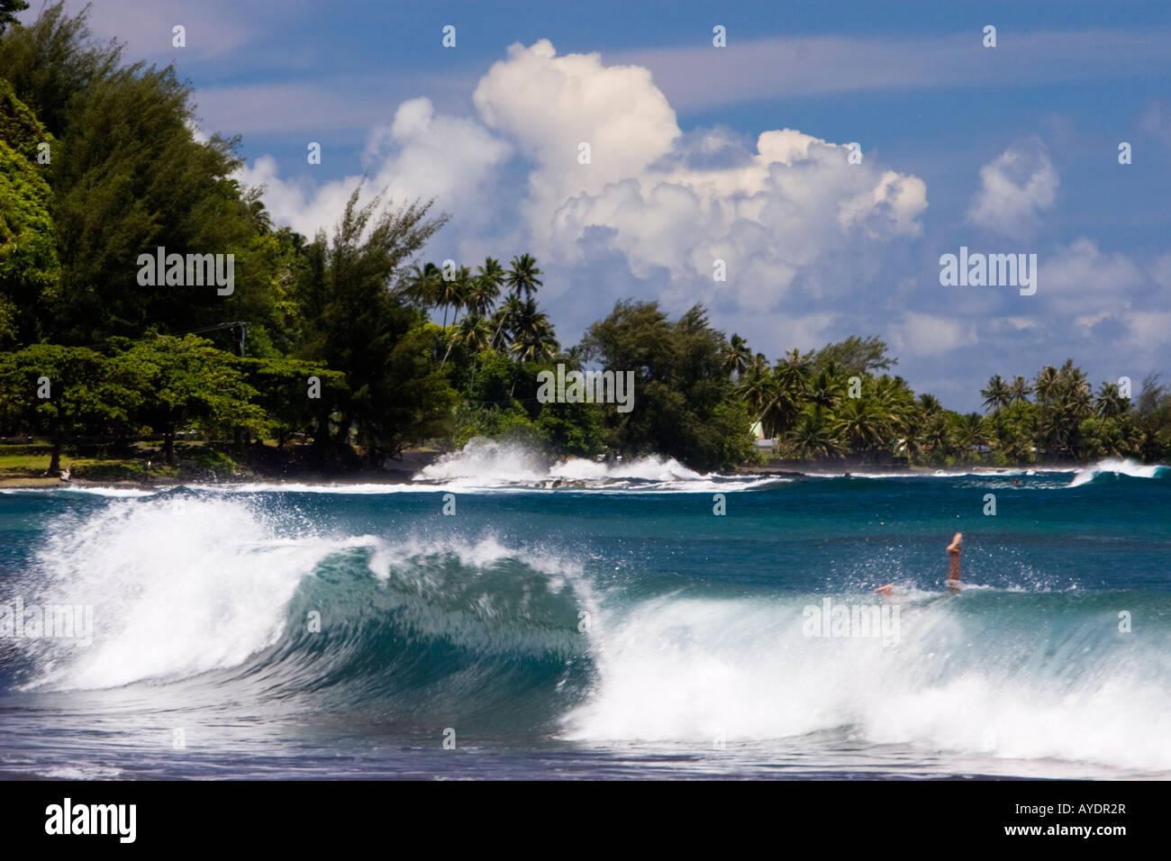 Big waves at Tahiti beach turn people upside down - Stock Image