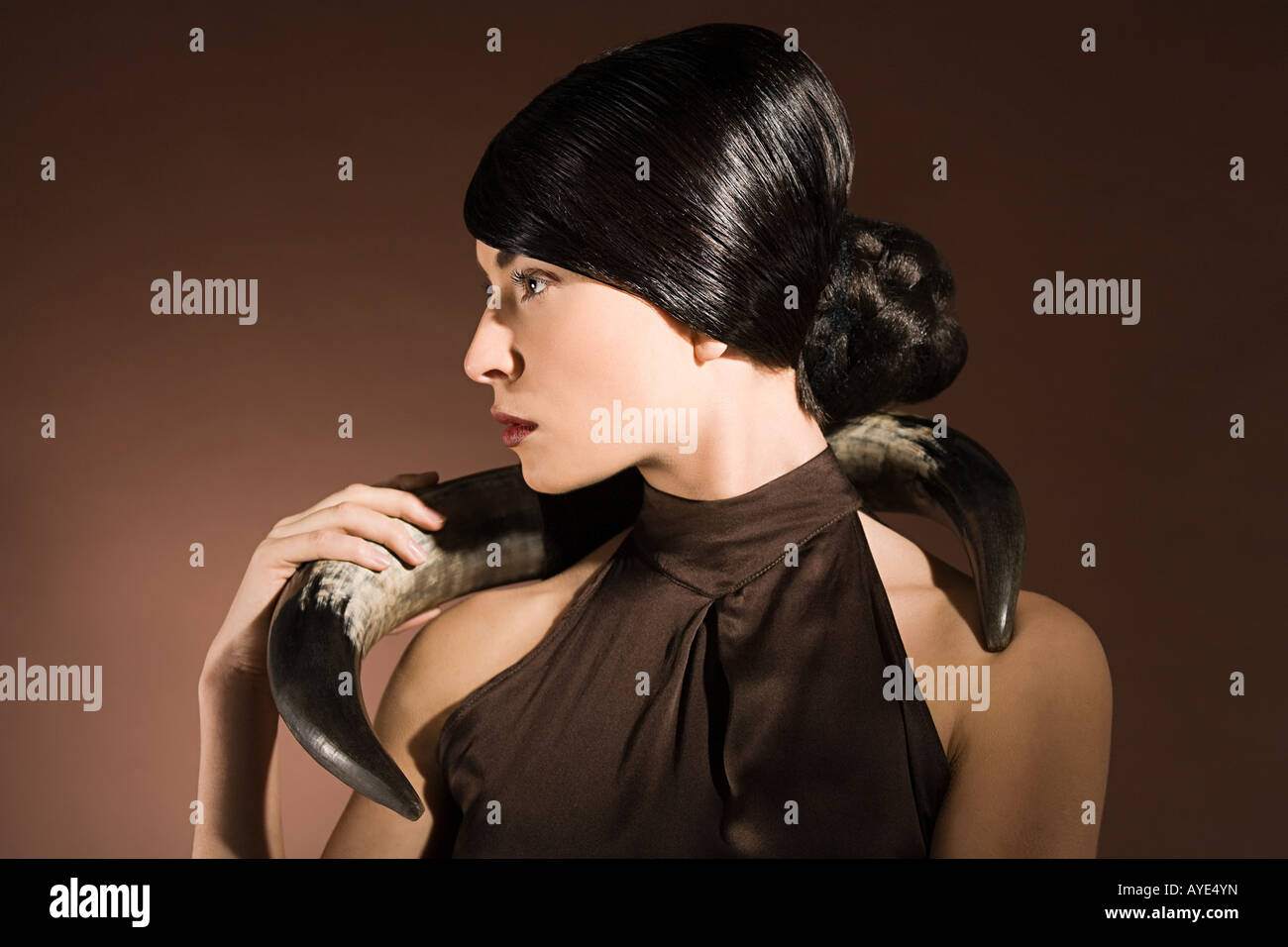 Young woman with animal horn - Stock Image