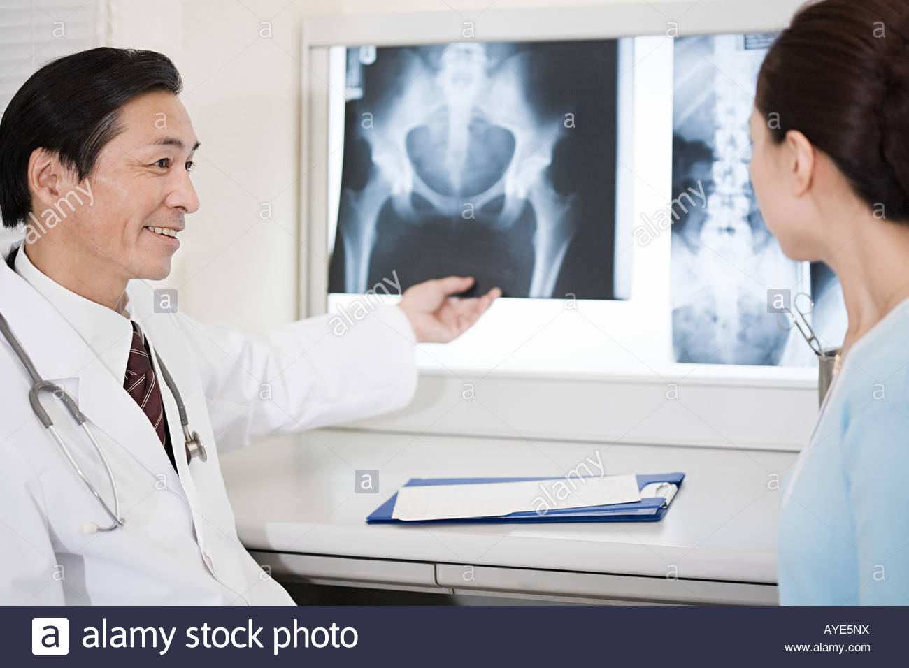Doctor and patient with x rays - Stock Image
