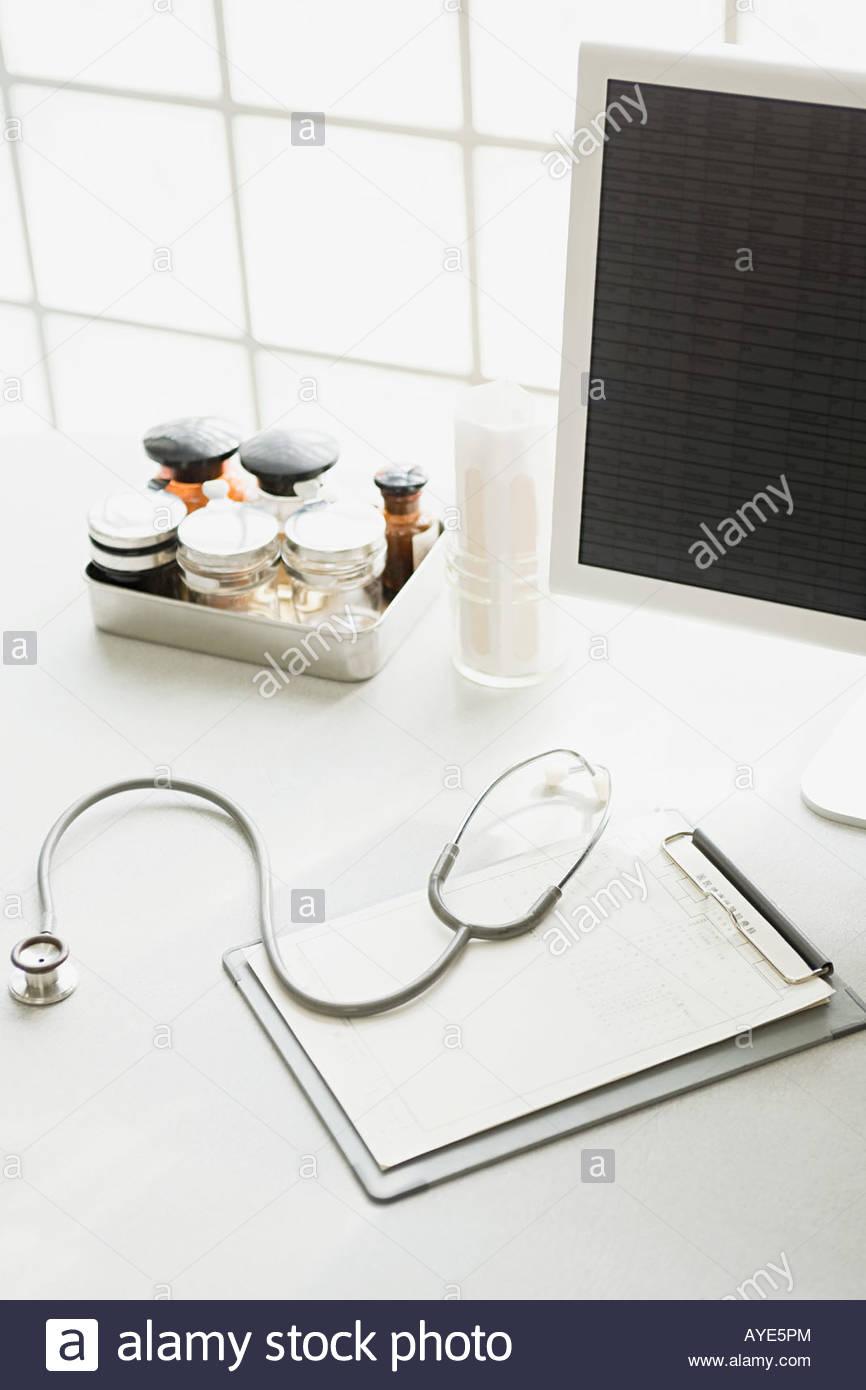 Desk in doctors office - Stock Image